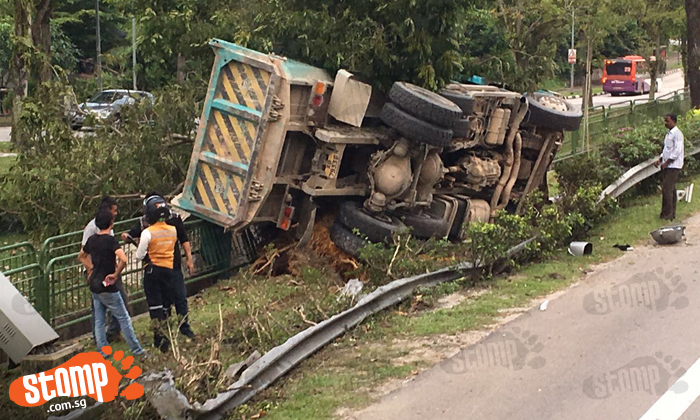 Truck topples over on its side after accident at Upper Seletar flyover