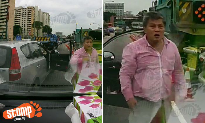 Cabby alights taxi in the middle of Braddell Road and challenges driver to a fight after refusing to give way