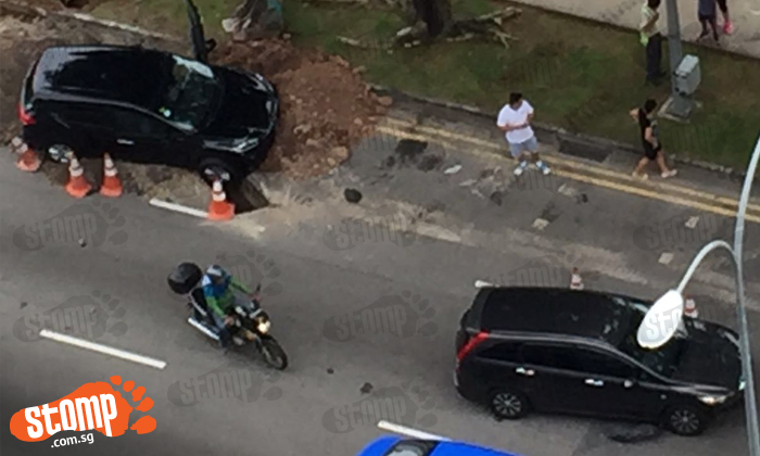 Workers carry girl and help passengers out of car after accident along Bartley Road