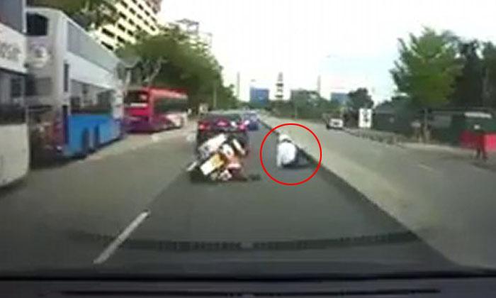Enforcement officer left sprawled on road after crashing his motorbike into car