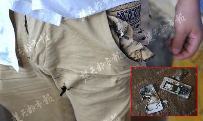 Chinese man is forced to strip on the streets after his phone explodes in his pocket