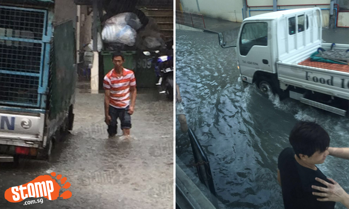 Office staff stranded and vehicles stuck after flood along Enterprise Road in Jurong