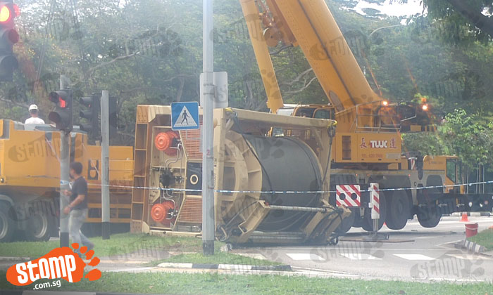 What happened? Huge machine topples off of lorry at West Coast Link