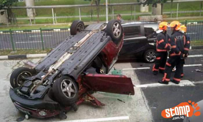 Car turns turtle in accident at Yishun Ave 2