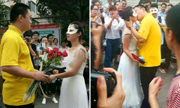 Female university professor wears wedding dress to propose to student in front of his classmates