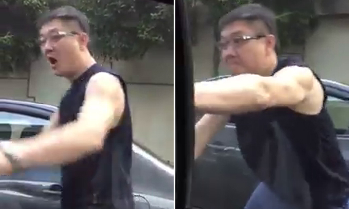 Road bully turns aggressive and tries to open driver's window after failing to cut queue at Customs