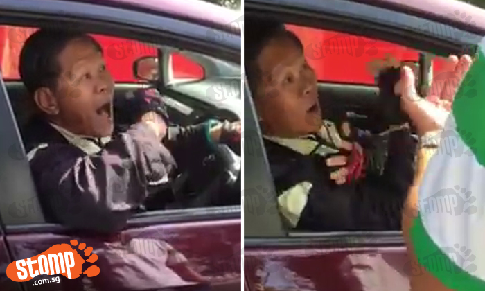 What's going on here? Cabby dares men to beat him up in expletive-laden argument
