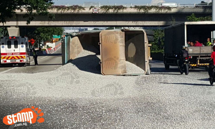Tipper truck topples at TPE, spilling gravel all over road and causing massive jam