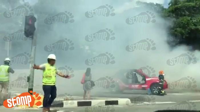 SCDF firefighters battle blaze from burning car at Mountbatten Road