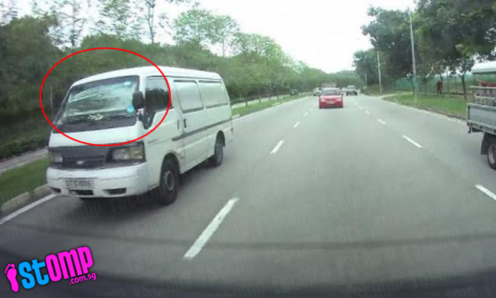 How can this driver even see the road with sunshade covering his windscreen?