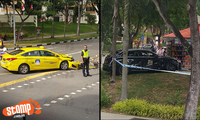 Car ends up on slope outside shop and taxi wrecked after Bedok Reservoir Rd accident