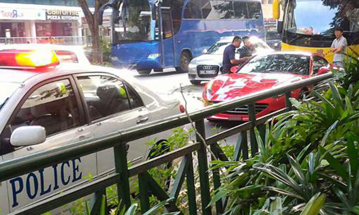 Angry woman stops her Ferrari in middle of busy Orchard Road -- to confront bus driver
