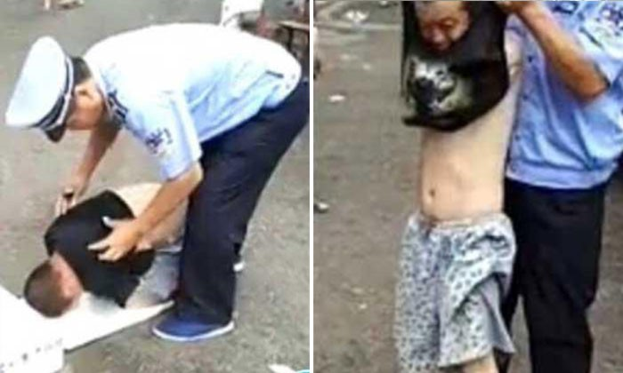 Oops! 'Armless' beggar in China exposed as fraud by security guard