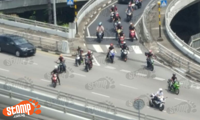 Bikers block path of vehicles -- so that their friends can filter to main road at Pasir Ris
