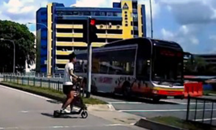 SMRT bus beats red light at Upper Boon Keng Road traffic junction -- while man and child are crossing