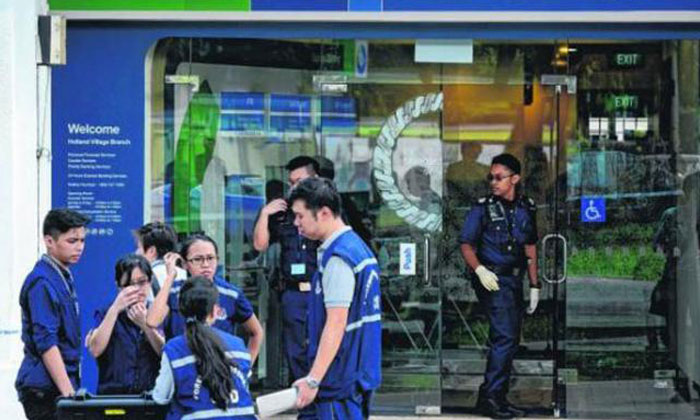 Holland Village bank robbery: Police on the hunt for Australian suspect