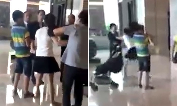 Woman whose son allegedly peed on sofa in hotel lobby shouts at and pushes female staff after being questioned