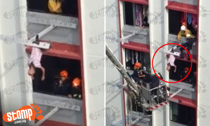 Watch chilling SCDF rescue of elderly man who fell out of window of Tampines Block 410