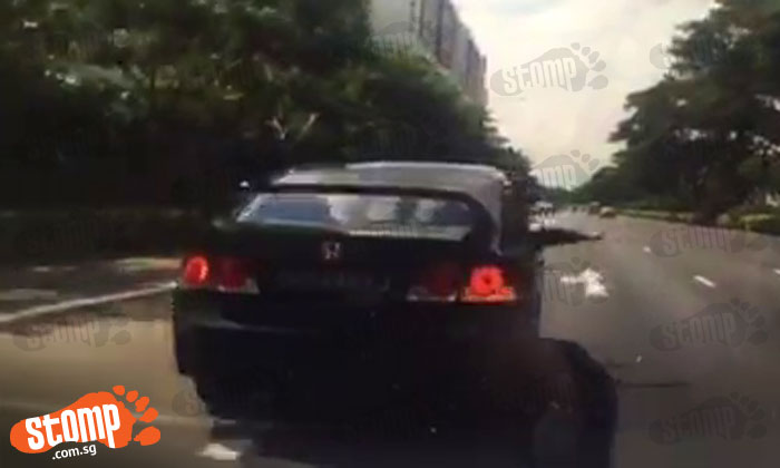 Driver tailgates Stomper and behaves aggressively despite having child on board