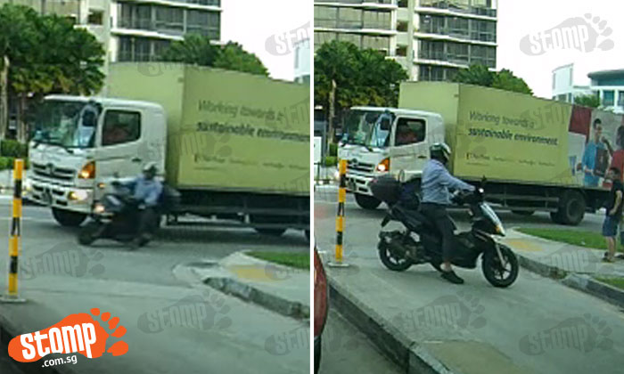 Biker gestures angrily after almost colliding with lorry driver at Simei St 6