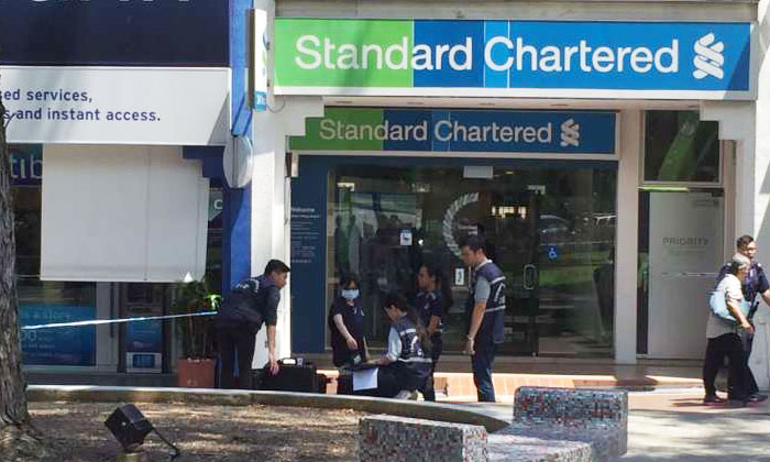 Police on islandwide hunt for suspected robber who made away with $20,000 from Standard Chartered bank at Holland Village