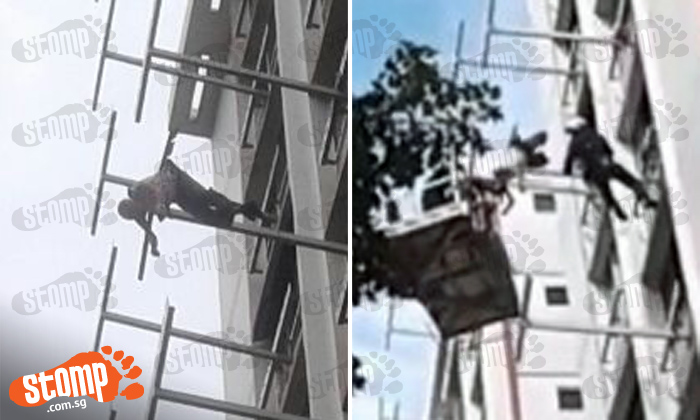 SCDF personnel climb out windows and use fire engine ladder to rescue elderly man on clothes rack at Tampines St 41
