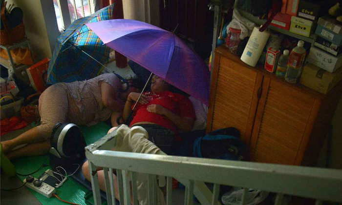 Mum and 24-year-old daughter sleep along corridor -- because 4-room AMK flat is too cluttered