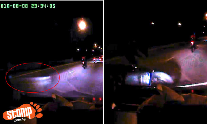 Biker sent flying after running over object lying on road at BKE