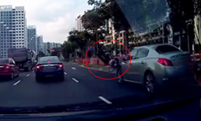 Female jaywalker sent flying after getting hit by oncoming car along Punggol Way