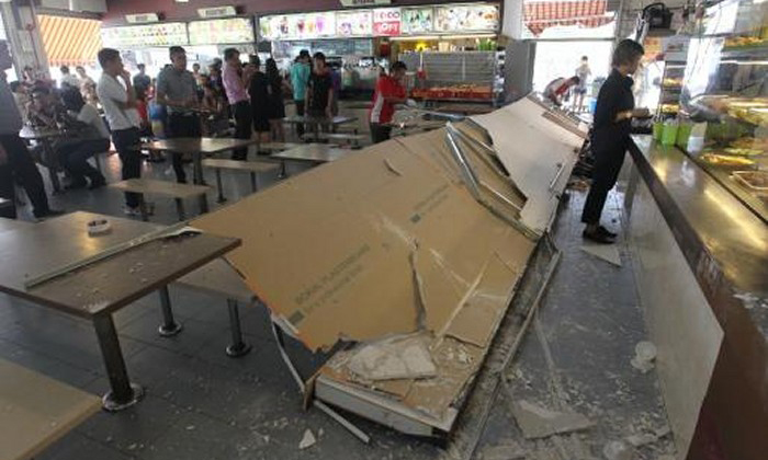 MacPherson coffee shop signboard and parts of ceiling fell on woman