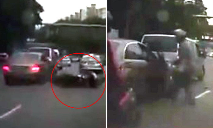 Motorcyclist skids and falls on his own, then inexplicably confronts nearby Merc driver
