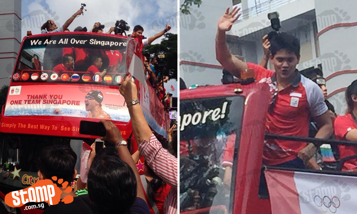 Crowds cheer as Joseph Schooling goes on victory parade around Singapore