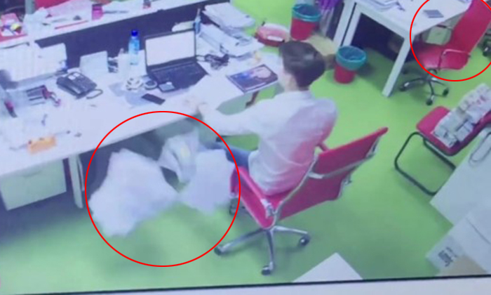 Chairs move and paper gets thrown at man who is alone in Malaysian telco office