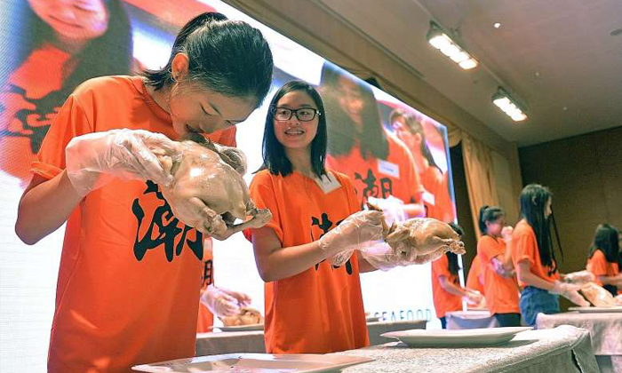 Biting a rooster's head and more: Students try Teochew coming-of-age ritual