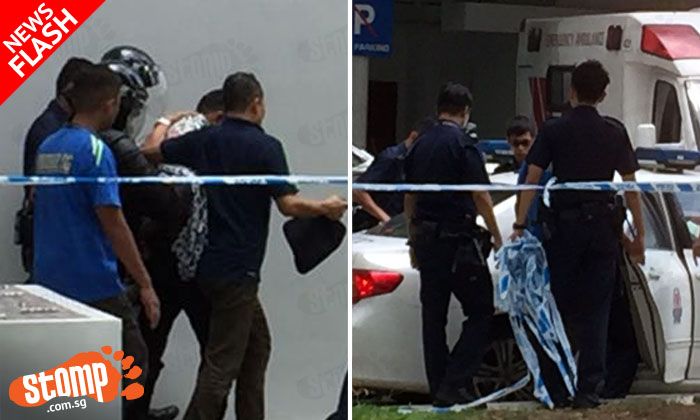 Man who locked himself with boy, 2, in Sembawang flat for 17 hours arrested after officer break down door