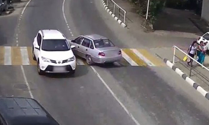 Champion driver in Russia U-turns onto wrong side of road... and keeps going