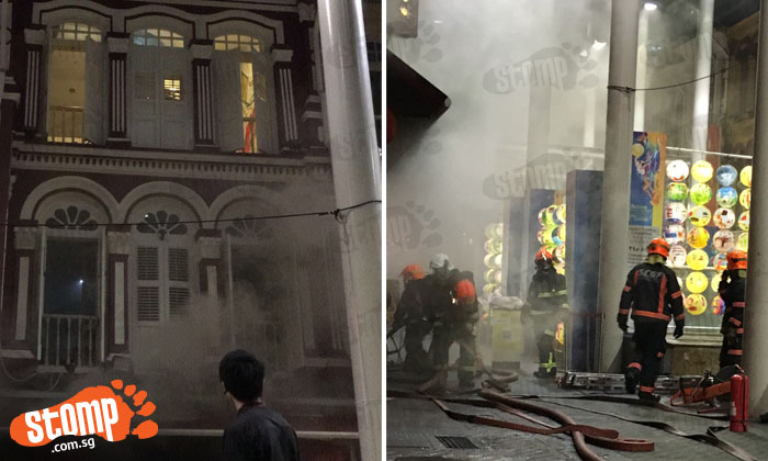 Onlookers stare as smoke engulfs Chinatown shophouses