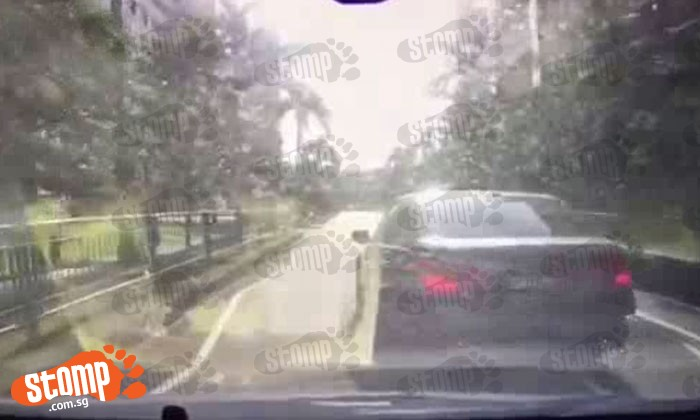 BMW driver jams on the brakes in front of another car while driving for no reason at all