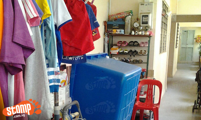 Yishun residents fed up with 'karung guni' neighbour who keeps clothes and bathtub along corridor