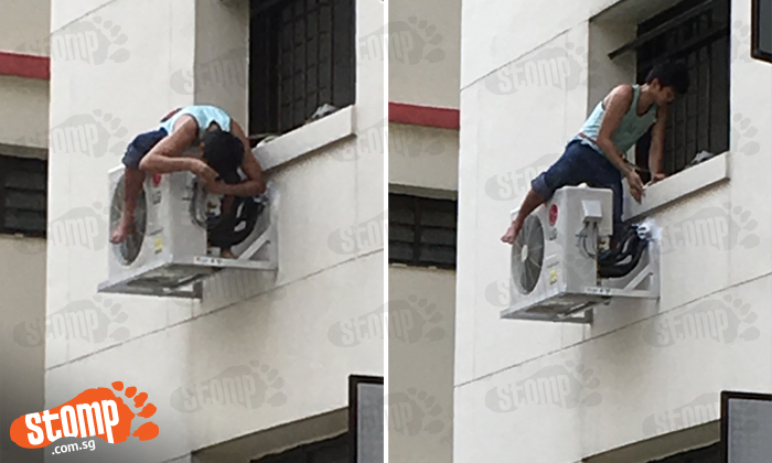 Does this man realise how dangerous it is of him to perch on air-con unit at Woodlands block?