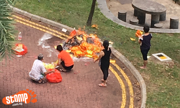 Fire hazard and mess alert: Admiralty residents burn offerings on the road instead of allocated bin nearby