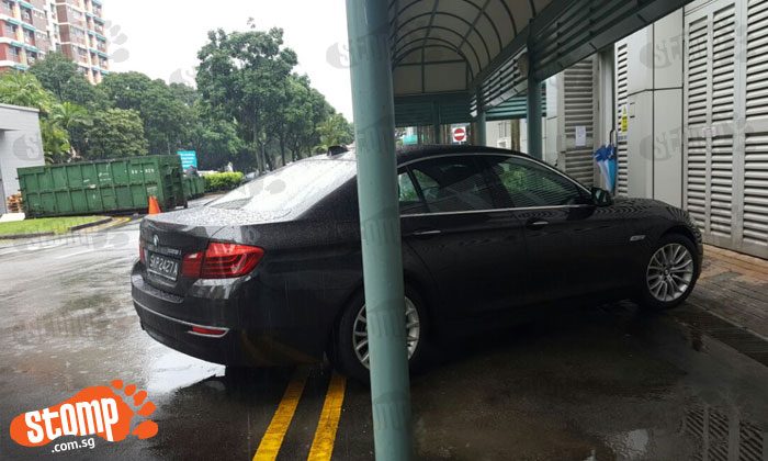 Driver finds ingenious way to protect his BMW from rain