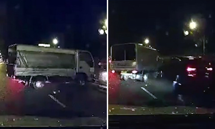 Lorry driver skids on rainy day and hits car -- then gets slammed by another vehicle