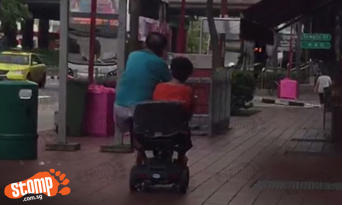 Isn't this dangerous? Uncle and auntie share a motorised wheelchair