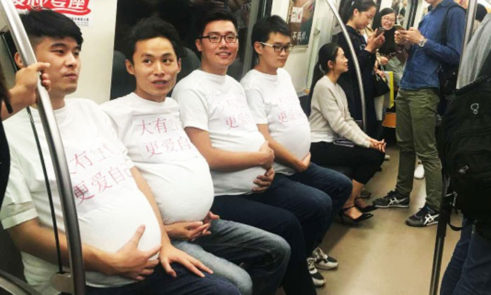'Pregnant' men boards train, asking for commuters to 'give them some space'