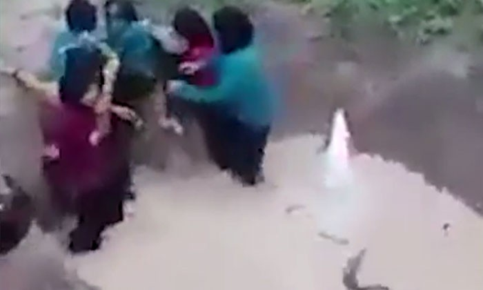 Students in Malaysia cry and scream as trainer throws snake into muddy pit with them