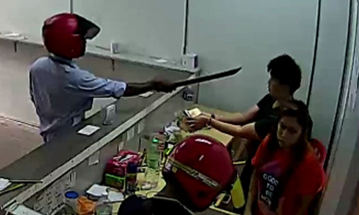 Watch how quickly things escalate after 'customers' take out parangs to rob store
