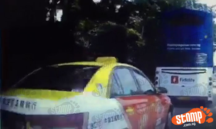 Taxi barges into car's lane along PIE towards Tuas and jams brakes causing near accident