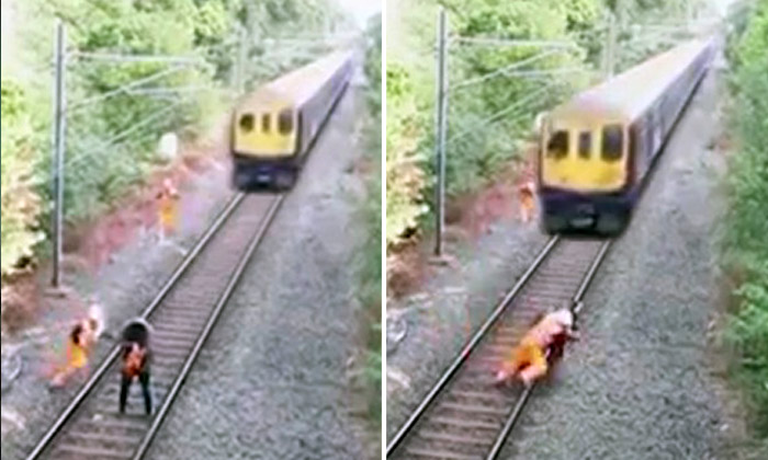 Railway worker puts his life on the line to save man from oncoming train