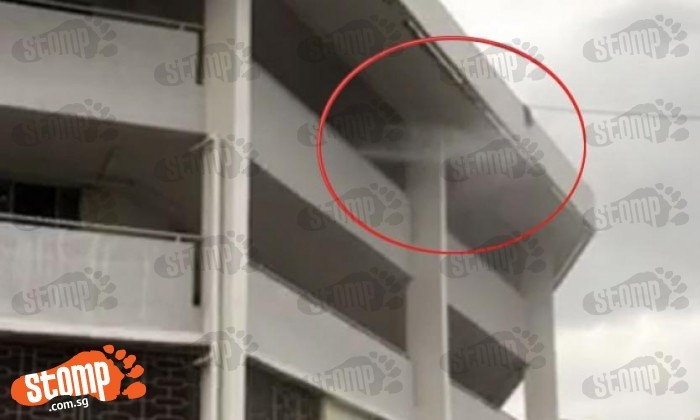 Oops! Best avoid this Ang Mo Kio block while its corridors are being cleaned by water jet
